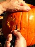 Man carving pumpkin Stock Photo