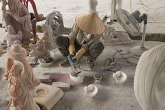 Man carving statuettes. Of white Marble in a Ha Long Bay Cermaics factory Royalty Free Stock Photography
