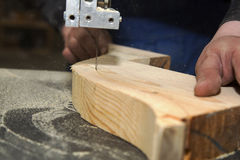 Man carving tree with electric tool Stock Images