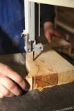 Man carving tree with electric tool Stock Image