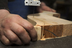 Man carving tree with electric tool Royalty Free Stock Photography