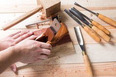 Man carving wood with handtools Royalty Free Stock Photography
