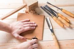 Man carving wood with handtools Royalty Free Stock Photos