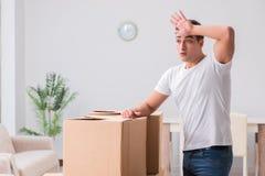 The man caryying boxes at home. Man caryying boxes at home Royalty Free Stock Photo