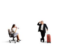 Man with case looking at woman Royalty Free Stock Photography