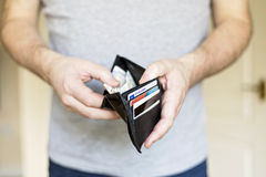 Man with cash inside wallet Stock Images