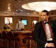 Man in casino interior Stock Photo