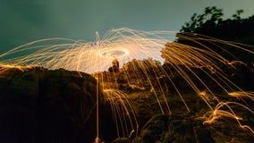 Man cast Fire steel wool Stock Photos