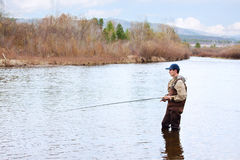 Man casting fly fishing rod Stock Photography