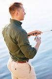 Man casting with light rod on the river Stock Photography
