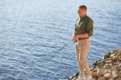 Man casting with light rod on the river Stock Images