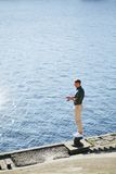 Man casting with light rod on the river Stock Image
