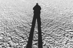 Man casting a long shadow Royalty Free Stock Image