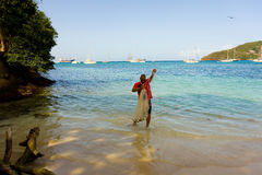 A man with a casting net in the caribbean Stock Photo