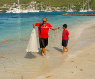 A man with a casting net in the caribbean Royalty Free Stock Images