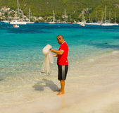A man with a casting net in the caribbean Stock Image