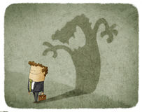 Man casting shadow of an angry man. Businessman standing and casting shadow of an angry man Royalty Free Stock Photos