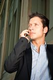 Man in Casual Business Attire. Talking on the Phone Outside Royalty Free Stock Photo