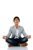 Man in casual cloth meditating Royalty Free Stock Photography