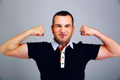 Man in casual cloth showing his biceps Stock Image