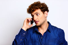 Man in casual cloth talking on the phone Stock Photos