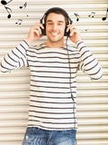 Man in casual clothes with headphones Stock Photos