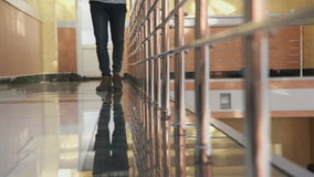 Man in casual clothes leisurely walks on the reflective floor. stock footage