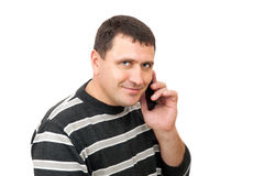 The man in casual clothes is speaken by cell telephone Stock Photos