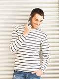 Man in casual clothes talking on the phone Royalty Free Stock Images