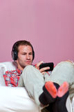 Man in casual clothing sat listening to music Royalty Free Stock Photography