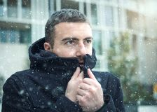 Man casual dressed in the city on a  winter seasonal day Stock Image