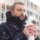 Man casual dressed in the city on a  winter seasonal day Stock Images