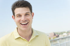 Man In Casual Laughing Against Clear Sky Royalty Free Stock Photography