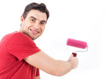 Man in casual with roller and painting wall Stock Photography