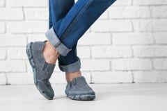 Man in casual shoes  и. Man in casual shoes near brick wall Stock Images