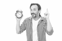 Man casual style hold alarm clock. Time management and procrastination. Take control of time. Check time. Idea of royalty free stock photography