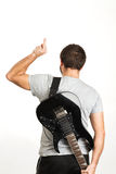 Man in casual wear, holding the guitar and standing isolated on Royalty Free Stock Photo