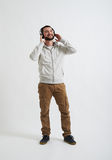 Man in casual wear is listening to music Stock Images