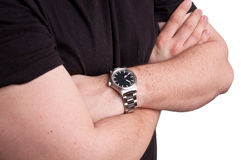 Man in casual wear with watch on hand standing with crossed arms Stock Images