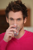 Man casually drinking water Stock Image