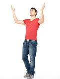 Man with  in casuals with raised hands up isolated. Young happy man in casuals with raised hands up isolated on white background Stock Image