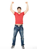 Man with  in casuals with raised hands up isolated. Young happy man with  in casuals with raised hands up isolated on white background Stock Photography