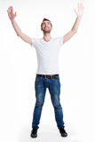 Man with  in casuals with raised hands up isolated. Young happy man in casuals with raised hands up - isolated on white Royalty Free Stock Photo