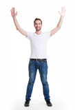 Man with  in casuals with raised hands up isolated. Young happy man in casuals with raised hands up - isolated on white Stock Photos