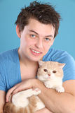 A man with a cat in her arms Royalty Free Stock Photo