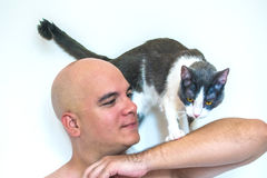 A man with a cat on his shoulders. A man with a cat on his shoulders with a white background Stock Photography
