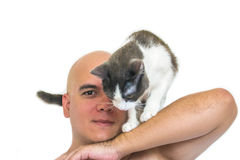 A man with a cat on his shoulders. A man with a cat on his shoulders with a white background Royalty Free Stock Photography