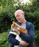 Man and cat Stock Photography
