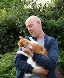 Man and cat stock photos