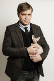 Man with cat, portrait Stock Images